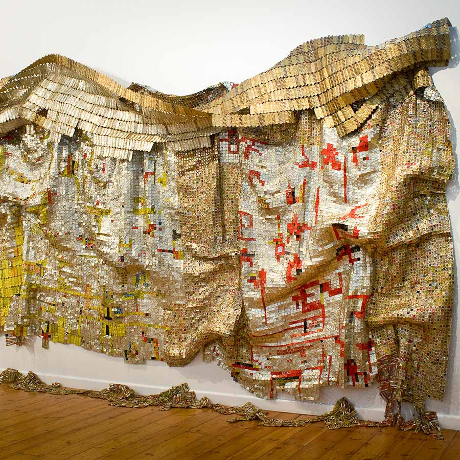 <strong>El Anatsui</strong>, <em>Skylines?</em>, 2008. Aluminium and copper, 245 x 825 cm.